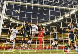 Sandra Sepulveda of Colombia punches the ball away despite the close attention of Karen Carney.