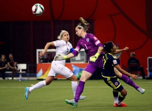 Karen Bardsley clatters into Carolina Arias as she blocks the ball with her face.