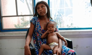 Paola Uriana, 17, sits with her daughter Sara Sofía Uriana, 7 months, in the Center for Nutritional Recuperation.