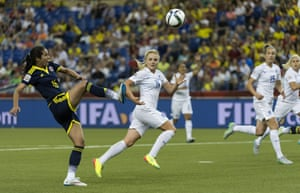England's Alex Greenwood and Casey Stoney, right, watch as Columbia forward Lady Andrade scores a consolation goal for Colombia.
