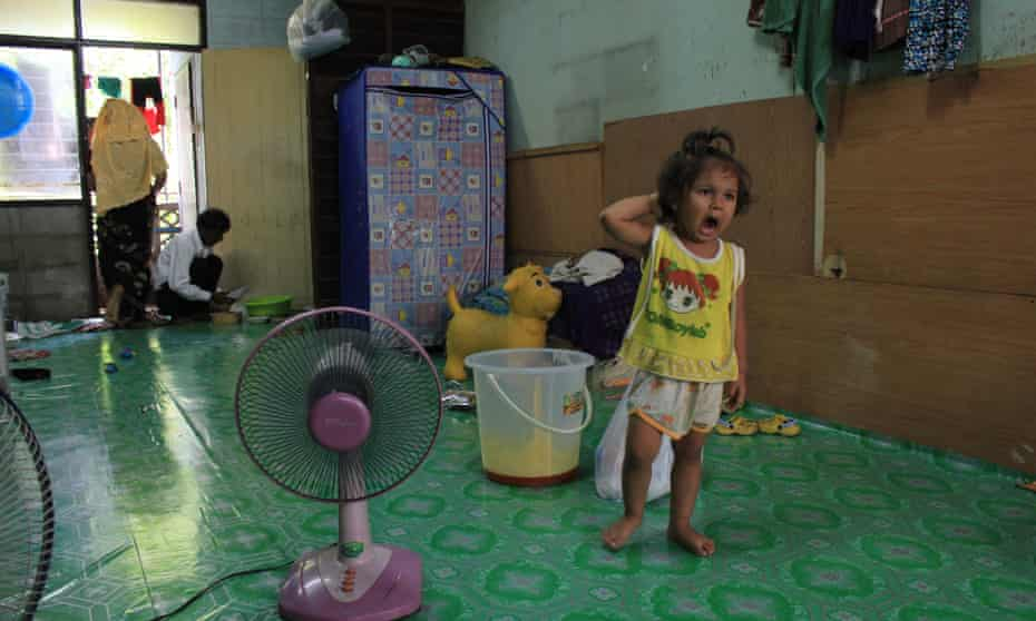 A Rohingya girl stands in her house on the outskirts of Bangkok, Thailand.