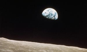 This view of the rising earth greeted the Apollo 8 astronauts as they came from behind the moon after the lunar orbit insertion burn.