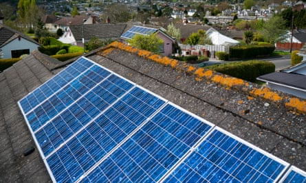 Solar panels on a roof in Totnes, Devon. Amber Rudd claims solar power is just as cost-effective as onshore wind.