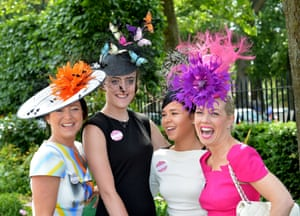 Racegoers in colourful headgear