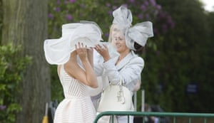 Last-minute straightening of headgear as racegoers arrive