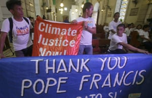 "Environmental activists display a banner as they prepare to listen to speeches inside a Roman Catholic church to coincide with Pope Francis' encyclical on climate change Thursday, June 18, 2015 in Manila, Philippines. In a high-level, 190-page document released Thursday, Francis  describes ongoing human damage to nature as ""one small sign of the ethical, cultural and spiritual crisis of modernity."" The solution, he says, will require self-sacrifice and a ""bold cultural revolution"" worldwide."