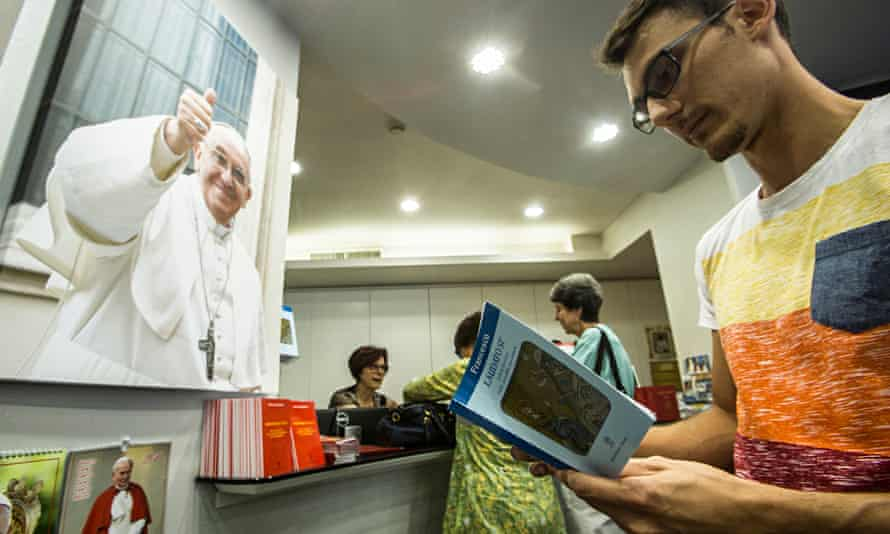 People buy copies of Pope Francis's encyclical letter Laudato Si'