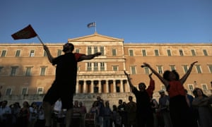 Protesters rally against austerity in front of the Greek parliament.
