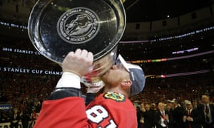Chicago Blackhawks Marian Hossa, of Slovakia, kisses the Stanley Cup Trophy after defeating the Tampa Bay Lightning in Game 6.