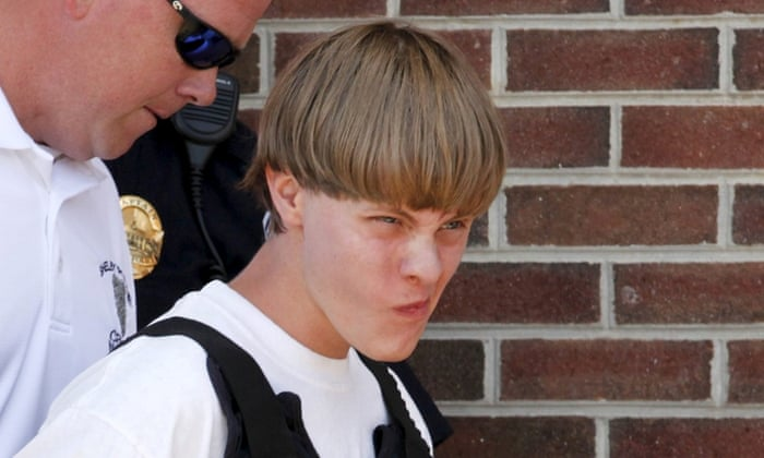 Police lead suspected shooter Dylann Roof, 21, into the courthouse in Shelby, North Carolina, June 18, 2015.