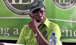 Jack Warner listens to the speaker during a cottage meeting of his political organisation, the Independent Liberal Party, in the village of Surrey, Lopinot, Arouca, in Trinidad.