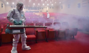 South Korean health officials fumigate a theatre in<br>Seoul in an attempt to combat the Mers virus. <br>