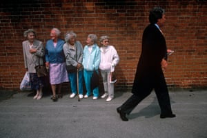 <strong>1992</strong> Five pensioners line up outside Ascot on Ladies' Day, watching the racegoers head into the course.