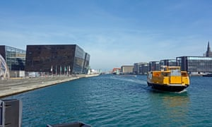 Movia water bus approaches the Royal Danish Library stop on the waterfront in Copenhagen, Denmark