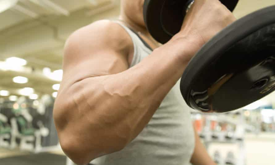 Man lifting dumbbell in gym