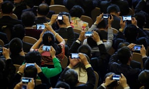 Delegates use their smartphones