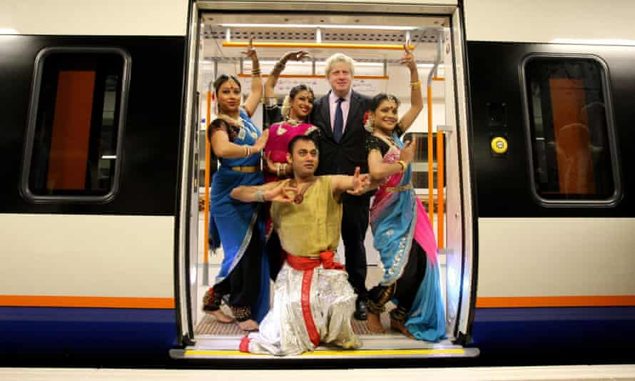 Mind the gap: Boris Johnson with Indian dancers at a London Overground opening event  in 2010.