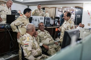 Officers talk in the Baghdad Operations Command control room