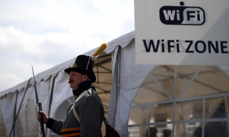 A historical re-enactor outside the Wi-Fi tent at the Allied bivouac encampment in Belgium this week – he joined 5,000 war re-enactors who took part in the 200th anniversary of the Battle of Waterloo.