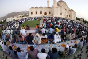 A photograph made with a fisheye wide angled lens, shows the Muslim devotees break their fast in the Omani capital Muscat.