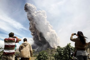 Karo, Indonesia Local residents watch the Mount Sinabung volcanic eruption