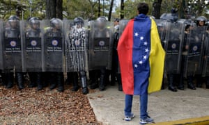Venezuela has consistently ranked in last place over various aspects of the rule of law, including police brutality and accountability … a Venezuelan student stands in front of riot police during a protest in Caracas in March 2014.