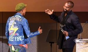 Kanye West presents the Fashion Icon Award to Pharrell Williams.