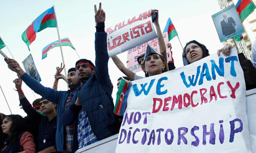 People attend an opposition rally in Baku