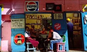 Rum Shack Bar in West Indies, Guinness and pepsi logos are shown and four men are sat chatting
