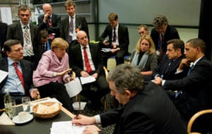 German Chancellor Angela Merkel (C) negotiates with president of the European Commission, Jose Manuel Barroso (L), Sweden's prime minister and standing president of the European Council, Fredrik Reinfeldt, (R), French President Nicolas Sarkozy, US President Barack Obama and British Prime Minister Gordon Brown the procedure of the European group of negotiations and the USA for the World Climate Conference during the final night of the UN Climate Change Summit on December 18, 2009 in Copenhagen, Denmark.