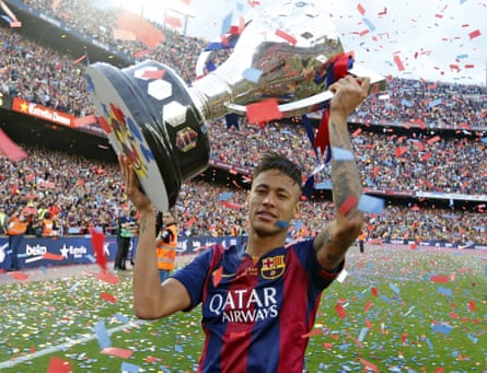 Barcelona's Neymar with the trophy after their La Liga title triumph.
