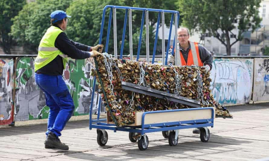 At last! Workers remove padlocks from the Pont des Arts in Paris.