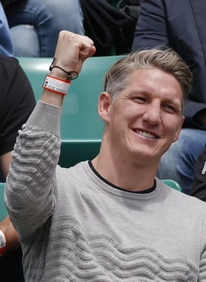 Bayern & Germany football player Bastian Schweinsteiger clenches his fist as Serbia's Ana Ivanovic wins a point.