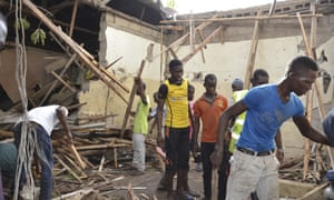 Rescue workers gather at the site of an explosion in Maiduguri, Nigeria, on Saturday