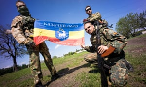 Foreign volunteer fighters for the Donetsk People's Republic are seen during a military exercise in Donetsk, Ukraine.