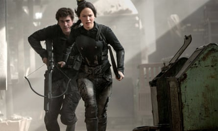 Jennifer Lawrence and Liam Hemsworth as Katniss and Gale.