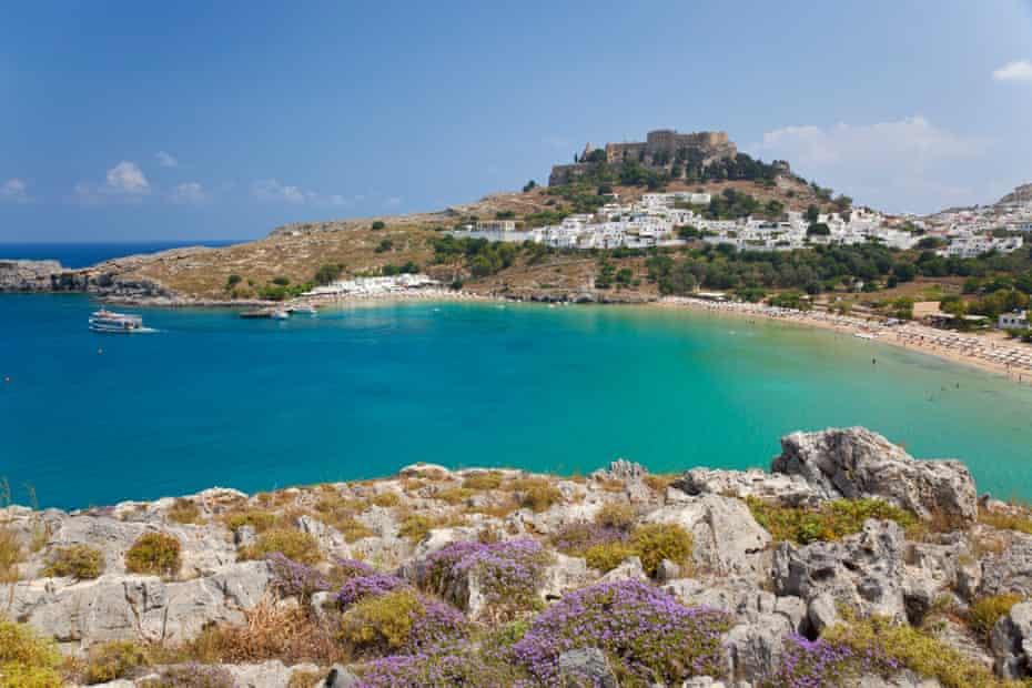 Lindos, Rhodes, Greece --- Lindos Beach, Lindos, Rhodes Island, Dodecanese Islands, Greece --- Image by   Peter Adams/CorbisAegean IslandsbaybeachcoastcoveDodecanese IslandsEuropeGreeceincidental peopleLindosmarine scenenobodyRhodesSouth Aegean Peripherytravelurban scenewater