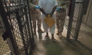 US military guards move a detainee inside Camp VI at Guantanamo Bay, Cuba in 2010.
