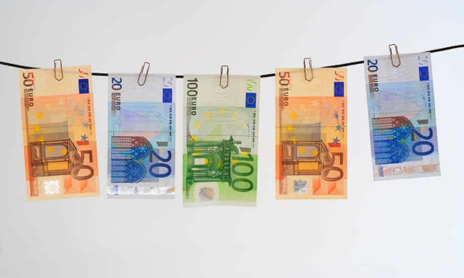 Euro notes hanging on a washing line.