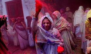 Widows take part in the Holi festival in Vrindavan