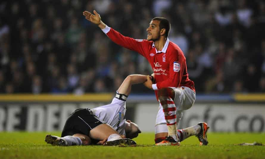 Nottingham Forest's Marcus Tudgay, right, calls for assistance after Derby County's Shaun Barker goes down injured during the npower Football League Championship match at Pride Park, Derby.football soccer derby ampics