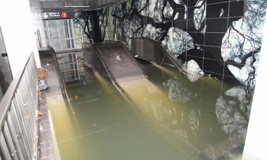 Escalators to the South Ferry Whitehall St. subway station in the financial district of Manhattan are shown flooded in the aftermath of Hurricane Sandy.  A new study finds that without human-caused global warming, the New York subways might not have been flooded.