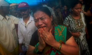 An Indian woman grieves for her husband, one of the victims of tainted bootleg liquor.