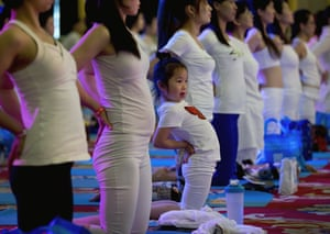 A child performs yoga at a hotel banquet hall to mark the International Yoga Day, Beijing, China