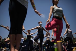 A woman wearing a mask takes part in the International Yoga Day event in Seoul, South Korea