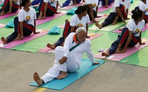 India's Prime Minister Narendra Modi participates in a yoga session to mark International Day of Yoga, in New Delhi, India. Modi led tens of thousands of people in the yoga session in the centre of the capital on Sunday to showcase the country's signature cultural export, which has prompted criticism of fomenting social divisions at home.