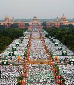 "Thousands of participants perform yoga on Rajpath in New Delhi. Prime Minister Narendra Modi hailed the first International Yoga Day as a ""new era of peace"", moments before he surprised thousands in New Delhi by taking to a mat himself to celebrate the ancient Indian practice."