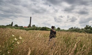 An Afghan migrant walks among the fields surrounding an abandoned brick factory on the outskirts of Subotica, Serbia. Migrants call the space the jungle.