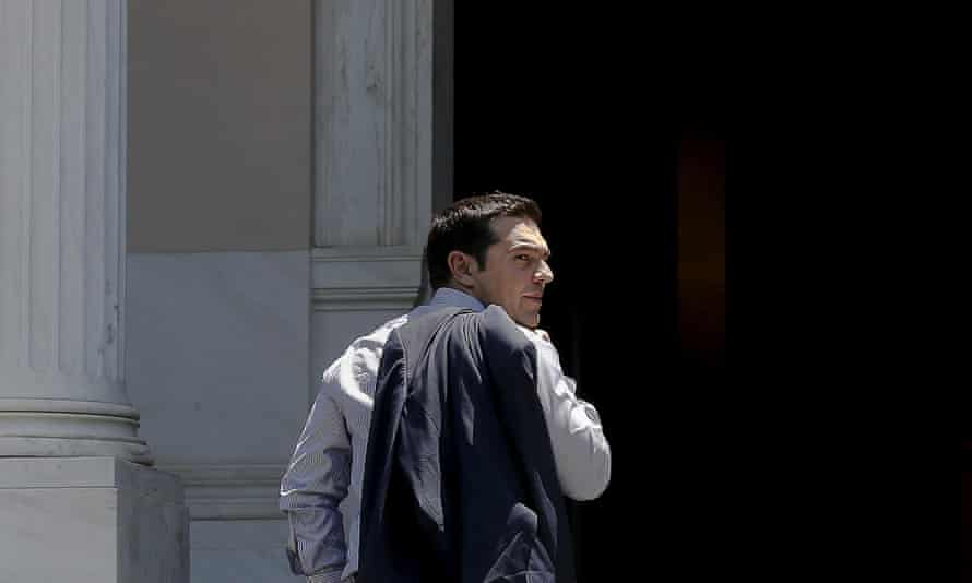 The Greek prime minister Alexis Tsipras looks on as he arrives at this office at Maximos Mansion in Athens June 20, 2015