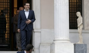 The Greek prime minister, Alexis Tsipras, leaves his office in Athens on Sunday.